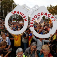 People hold a giant pair of handcuffs during a demonstration organised by Catalan pro-independence movements ANC (Catalan National Assembly) and Omnium Cutural, following the imprisonment of their two leaders, in